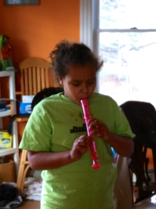 GB practicing the recorder.